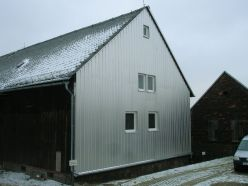 Fassadenverkleidung einer Mühle in Hirschfeld mit Alu Trapezblech